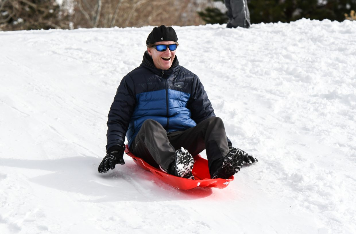 No. 3 - John Michelle is all smiles as he sleds down a hill near Cardiff Glen in Glenwood Springs.