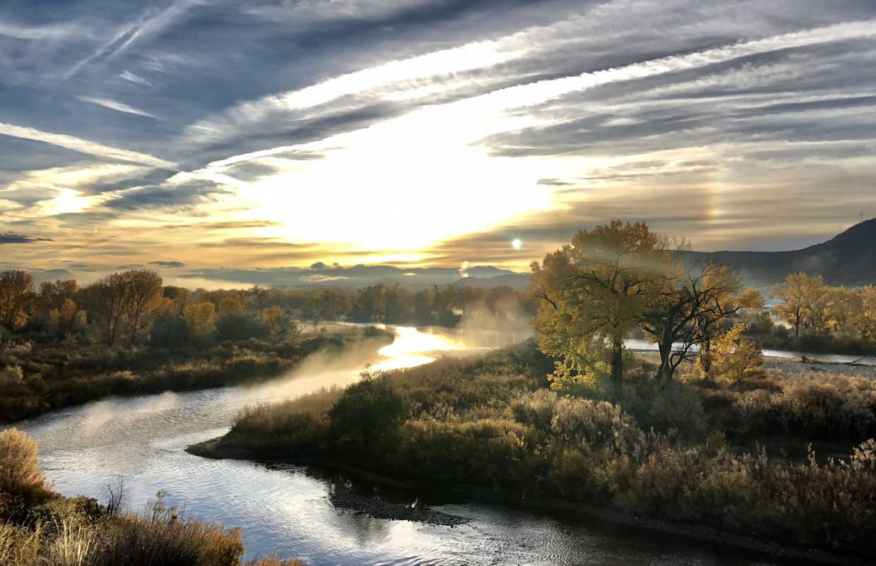 No. 7 - The sun rises above the Colorada River valley near Rifle Tuesday, illuminating the final hints of fall clinging to the trees along the banks.