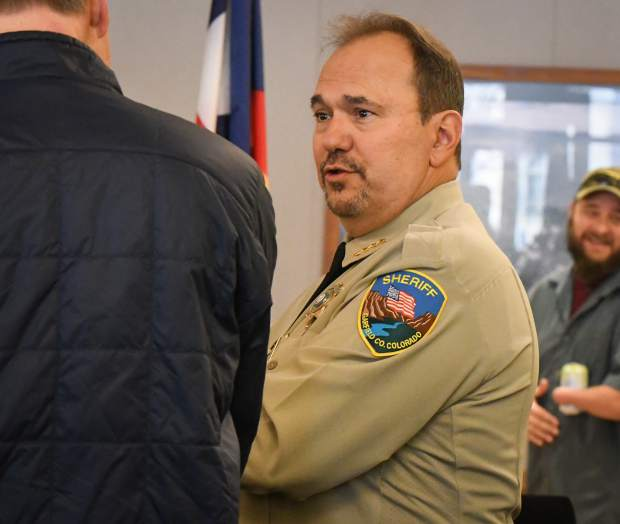 Garfield County Sheriff Lou Valllario interacts with members of the community during the public swearing-in ceremony held on Tuesday morning.