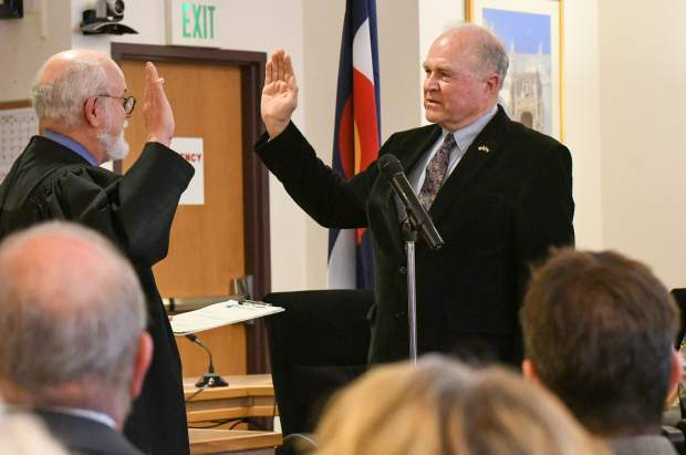 Garfield County Commissioner Tom Jankovsky is sworn into a third term in office at the public swearing-in ceremony held on Tuesday morning.