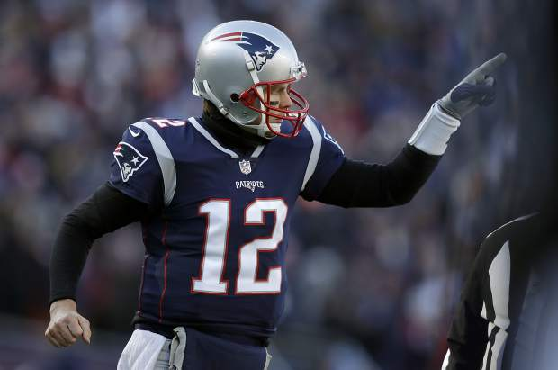 New England Patriots quarterback Tom Brady celebrates one of his team's five first-half touchdowns against the Los Angeles Chargers during the first half of an NFL divisional playoff football game, Sunday, Jan. 13, 2019, in Foxborough, Mass. (AP Photo/Charles Krupa)