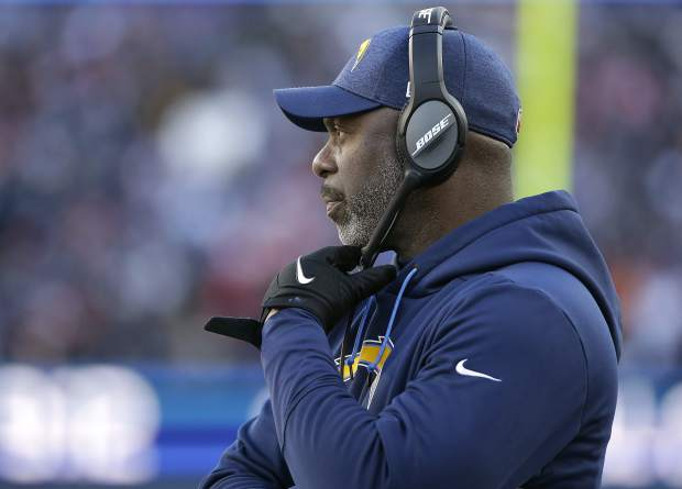 Los Angeles Chargers head coach Anthony Lynn watches from the sideline during the first half of an NFL divisional playoff football game against the New England Patriots, Sunday, Jan. 13, 2019, in Foxborough, Mass. (AP Photo/Steven Senne)