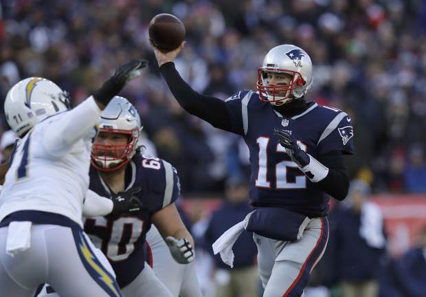 New England Patriots quarterback Tom Brady (12) passes under pressure from Los Angeles Chargers defensive end Damion Square (71) during the first half of an NFL divisional playoff football game, Sunday, Jan. 13, 2019, in Foxborough, Mass. (AP Photo/Charles Krupa)