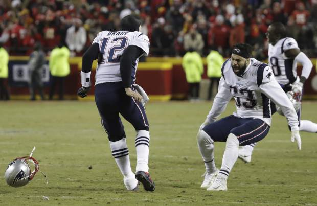 New England Patriots quarterback Tom Brady (12) celebrates with middle linebacker Kyle Van Noy (53) after defeating the Kansas City Chiefs in AFC Championship NFL football game in overtime, Sunday, Jan. 20, 2019, in Kansas City, Mo. (AP Photo/Elise Amendola)