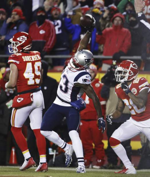 New England Patriots wide receiver Phillip Dorsett (13) spikes the ball as he celebrates a touchdown reception during the first half of the AFC Championship NFL football game against the Kansas City Chiefs, Sunday, Jan. 20, 2019, in Kansas City, Mo. (AP Photo/Charlie Riedel)