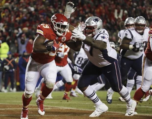Kansas City Chiefs inside linebacker Reggie Ragland (59) runs against New England Patriots offensive tackle Trent Brown (77) after intercepting a pass during the first half of the AFC Championship NFL football game, Sunday, Jan. 20, 2019, in Kansas City, Mo. (AP Photo/Elise Amendola)