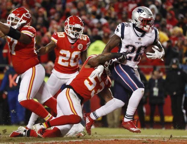 New England Patriots running back Sony Michel (26) runs to the end zone for a touchdown during the first half of the AFC Championship NFL football game against the Kansas City Chiefs, Sunday, Jan. 20, 2019, in Kansas City, Mo. (AP Photo/Jeff Roberson)