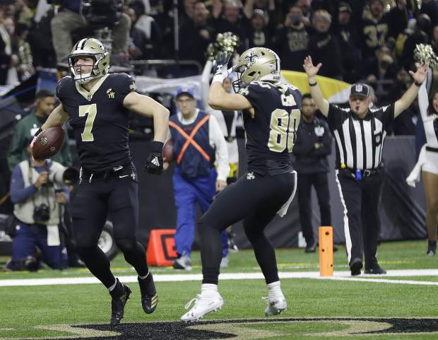 New Orleans Saints' Taysom Hill celebrates his touchdown catch during the second half the NFL football NFC championship game against the Los Angeles Rams, Sunday, Jan. 20, 2019, in New Orleans. (AP Photo/David J. Phillip)
