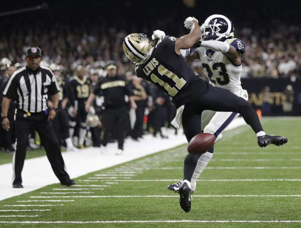 New Orleans Saints wide receiver Tommylee Lewis (11) works for a coach against Los Angeles Rams defensive back Nickell Robey-Coleman (23) during the second half the NFL football NFC championship game Sunday, Jan. 20, 2019, in New Orleans. The Rams won 26-23. (AP Photo/Gerald Herbert)