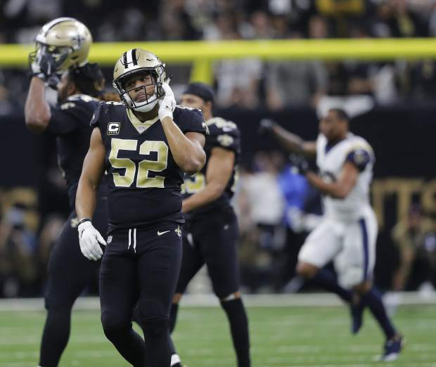 New Orleans Saints linebacker Craig Robertson (52) leaves the field after overtime of the NFL football NFC championship game against the Los Angeles Rams, Sunday, Jan. 20, 2019, in New Orleans. The Rams won 26-23. (AP Photo/Gerald Herbert)