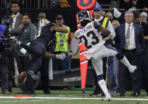 New Orleans Saints wide receiver Tommylee Lewis (11) misses the catch against Los Angeles Rams defensive back Nickell Robey-Coleman (23) during the second half the NFL football NFC championship game Sunday, Jan. 20, 2019, in New Orleans. The Rams won 26-23.(AP Photo/Carolyn Kaster)