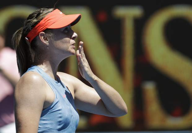 Russia's Maria Sharapova celebrates after defeating Britain's Harriet Dart during their first round match at the Australian Open tennis championships in Melbourne, Australia, Monday, Jan. 14, 2019. (AP Photo/Aaron Favila)