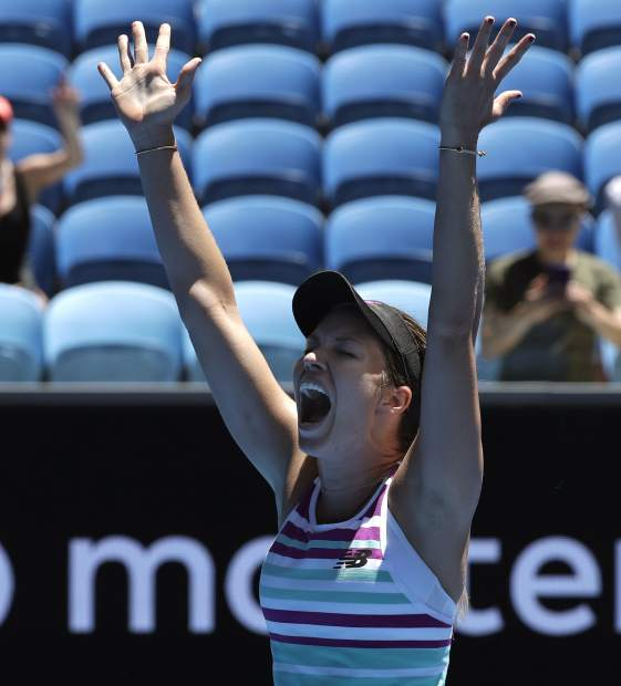 United States' Danielle Collins celebrates after defeating Germany's Julia Goerges in their first round match at the Australian Open tennis championships in Melbourne, Australia, Monday, Jan. 14, 2019. (AP Photo/Kin Cheung)