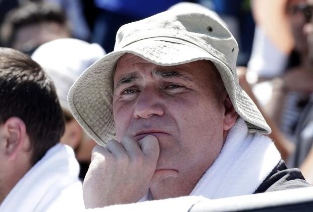 Andre Agassi, coach of Bulgaria's Grigor Dimitrov watches his first round match against Serbia's Janko Tipsarevic at the Australian Open tennis championships in Melbourne, Australia, Monday, Jan. 14, 2019. (AP Photo/Kin Cheung)