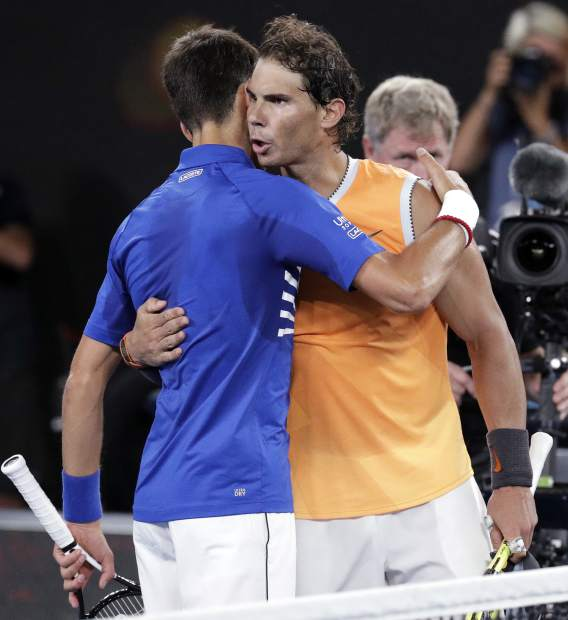 Spain's Rafael Nadal, right, congratulates Serbia's Novak Djokovic after Djokovic won the men's singles final at the Australian Open tennis championships in Melbourne, Australia, Sunday, Jan. 27, 2019. (AP Photo/Aaron Favila)