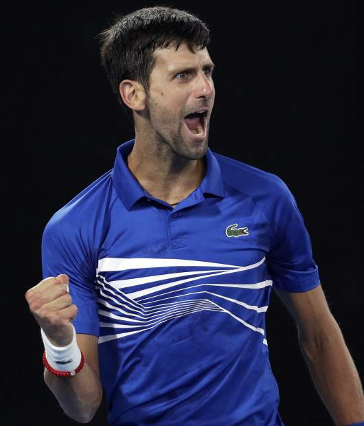 Serbia's Novak Djokovic reacts after winning a point against Spain's Rafael Nadal during the men's singles final at the Australian Open tennis championships in Melbourne, Australia, Sunday, Jan. 27, 2019. (AP Photo/Kin Cheung)