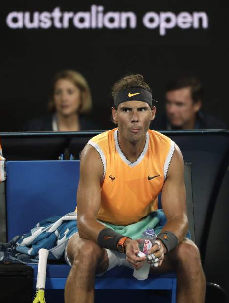 Spain's Rafael Nadal rests in his chair during a break in his match against Serbia's Novak Djokovic in the men's singles final at the Australian Open tennis championships in Melbourne, Australia, Sunday, Jan. 27, 2019. (AP Photo/Kin Cheung)
