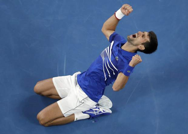 Serbia's Novak Djokovic celebrates after defeating Spain's Rafael Nadal in the men's singles final at the Australian Open tennis championships in Melbourne, Australia, Sunday, Jan. 27, 2019. (AP Photo/Mark Schiefelbein)