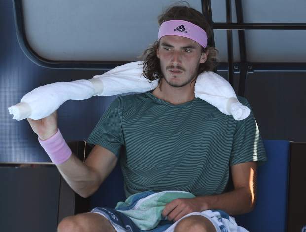 Greece's Stefanos Tsitsipas rests in his chair during a break in his quarterfinal match against Spain's Roberto Bautista Agut at the Australian Open tennis championships in Melbourne, Australia, Tuesday, Jan. 22, 2019. (AP Photo/Andy Brownbill)