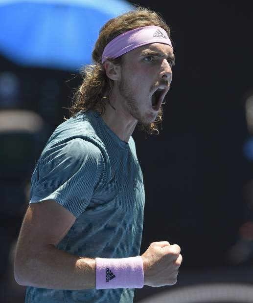 Greece's Stefanos Tsitsipas reacts during his quarterfinal match against Spain's Roberto Bautista Agut at the Australian Open tennis championships in Melbourne, Australia, Tuesday, Jan. 22, 2019. (AP Photo/Andy Brownbill)