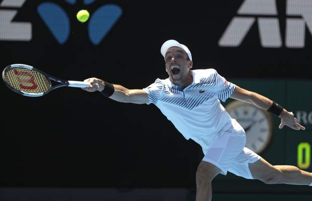 Spain's Roberto Bautista Agut makes a forehand return to Greece's Stefanos Tsitsipas during their quarterfinal match at the Australian Open tennis championships in Melbourne, Australia, Tuesday, Jan. 22, 2019. (AP Photo/Mark Schiefelbein)