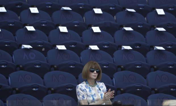 Anna Wintour watches the quarterfinal match between Spain's Roberto Bautista Agut and Greece's Stefanos Tsitsipas at the Australian Open tennis championships in Melbourne, Australia, Tuesday, Jan. 22, 2019. (AP Photo/Mark Schiefelbein)