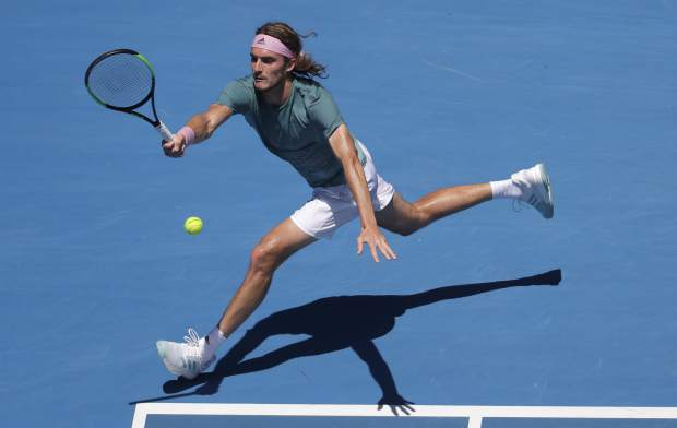 Greece's Stefanos Tsitsipas makes a forehand return to Spain's Roberto Bautista Agut during their quarterfinal match at the Australian Open tennis championships in Melbourne, Australia, Tuesday, Jan. 22, 2019. (AP Photo/Kin Cheung)