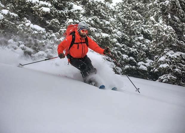 Colorado Avalanche Information Center (CAIC) forecaster Spenser Logan, of Boulder, makes a few ski turns in between work shifts on fresh overnight snow Thursday, Jan. 24, near Loveland Ski Area.