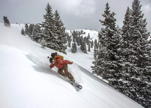 Frisco resident Phil Lindeman snowboards down a slope of fresh snow Saturday, Jan. 12, in the Eagles Nest Wilderness.