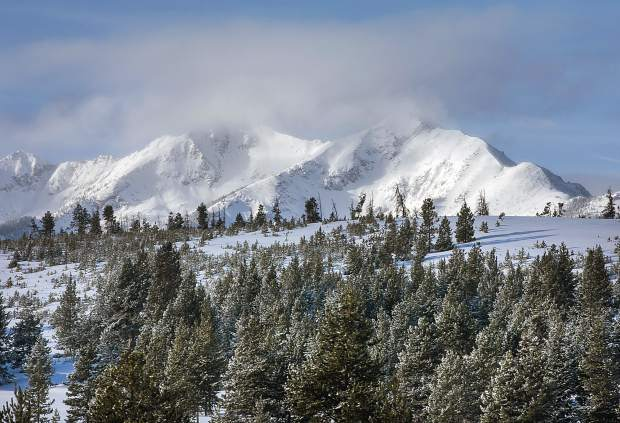 Clouds hover around the summits of the Tenmile Range, Tuesday, Jan. 22, near Frisco. This season has brought a strong snowpack to the mountains, with drought conditions improving.