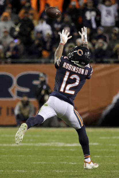 Chicago Bears wide receiver Allen Robinson (12) makes a catch during the second half of an NFL wild-card playoff football game against the Philadelphia Eagles Sunday, Jan. 6, 2019, in Chicago. (AP Photo/Nam Y. Huh)