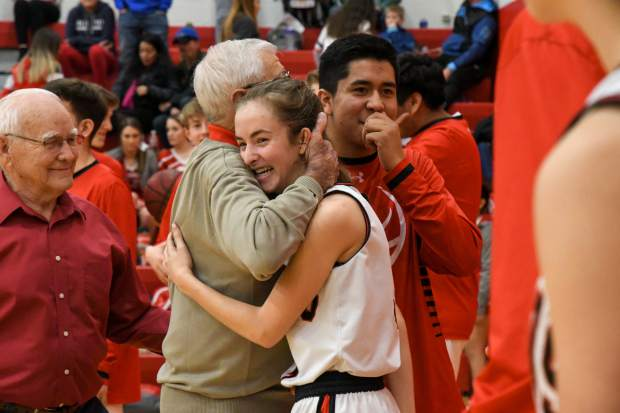 Former Glenwood Springs HIgh School boys basketball coach Bob Chavez interacts with players after a ceremony recognizing the 1978-79 undefeated team that took state forty years ago.