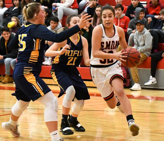 Glenwood Springs Demon Ximena Gutierrez dribbles the ball around the defending Rifle Bears during Friday night's game at Glenwood Springs High School.