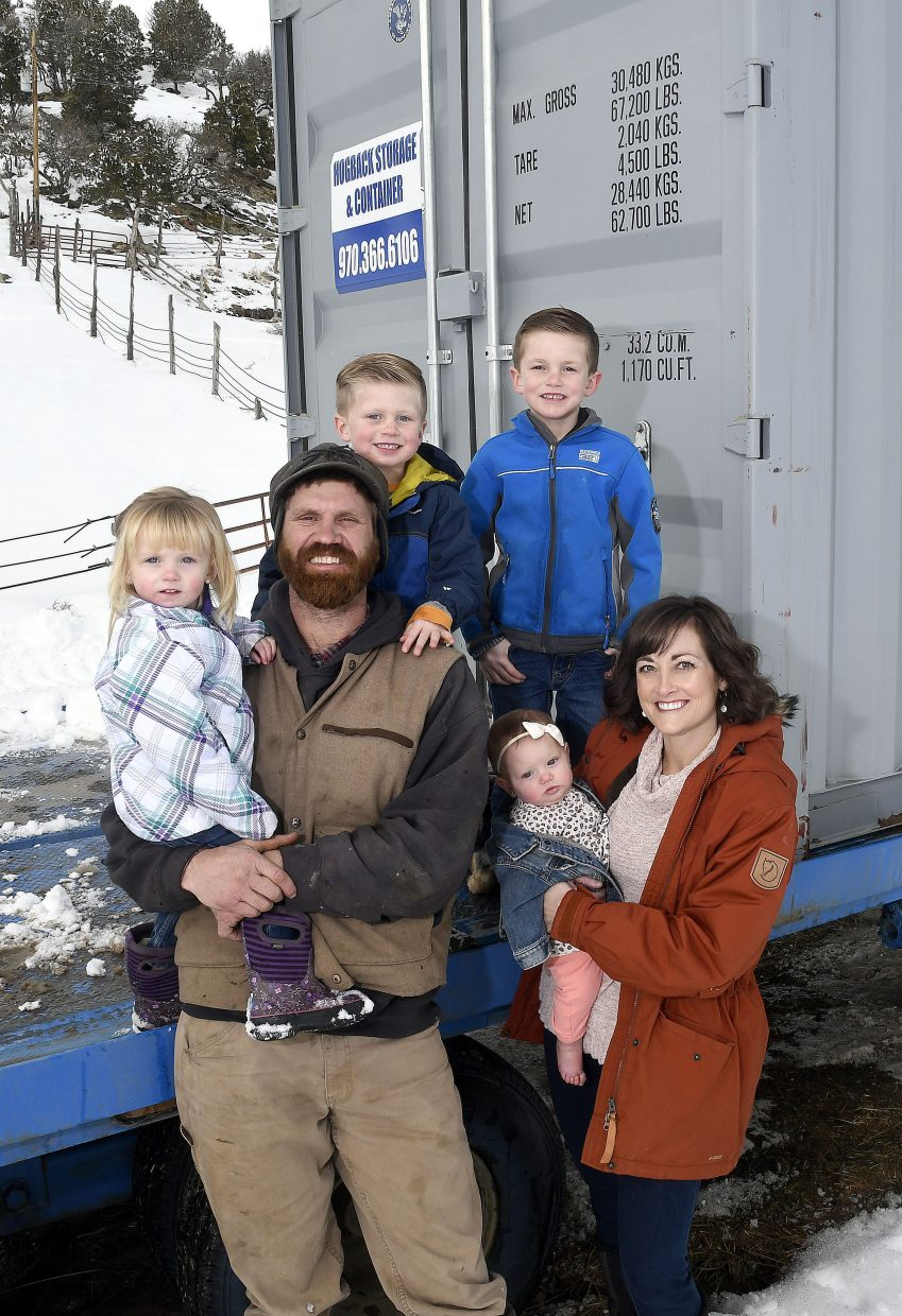 Thad Porter, owner of Hogback Storage, personally delivers his storage containers to customers, oftentimes with his whole family in tow.