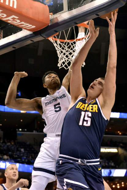 Denver Nuggets center Nikola Jokic (15) shoots against Memphis Grizzlies forward Bruno Caboclo (5) in the first half of an NBA basketball game Monday, Jan. 28, 2019, in Memphis, Tenn. (AP Photo/Brandon Dill)