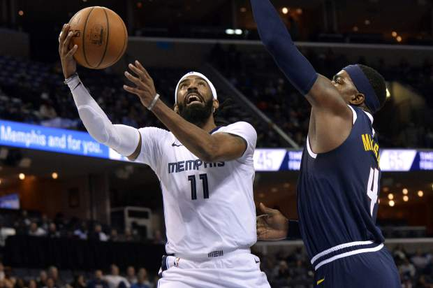 Memphis Grizzlies guard Mike Conley (11) shoots against Denver Nuggets forward Paul Millsap (4) in the second half of an NBA basketball game Monday, Jan. 28, 2019, in Memphis, Tenn. (AP Photo/Brandon Dill)