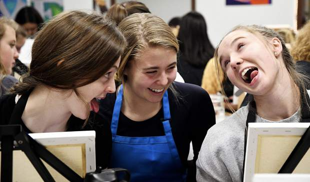 Junior Zeva Carruth, sophomore Maddie Moser and junior Hadley Yellico have a little fun selecting their subject.