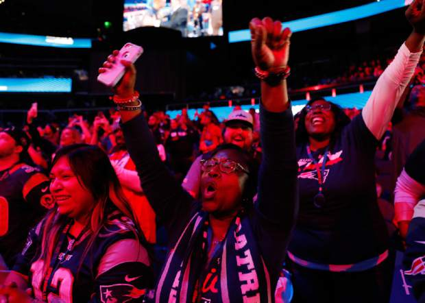 Fans cheer during Opening Night for the NFL Super Bowl 53 football game, Monday, Jan. 28, 2019, in Atlanta. (AP Photo/David Goldman)