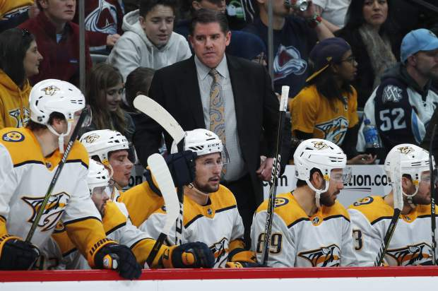 Nashville Predators head coach Peter Laviolette, back, directs his players in the second period of an NHL hockey game against the Colorado Avalanche Monday, Jan. 21, 2019, in Denver. (AP Photo/David Zalubowski)