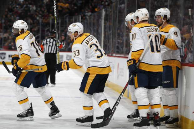 Nashville Predators right wing Viktor Arvidsson, second from left, celebrates scoring a goal with, from left, defenseman P.K. Subban, center Colton Sissons and left wing Filip Forsberg in the second period of an NHL hockey game against the Colorado Avalanche, Monday, Jan. 21, 2019, in Denver. (AP Photo/David Zalubowski)