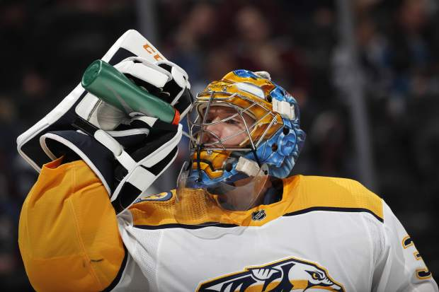 Nashville Predators goaltender Pekka Rinne takes a drink in the first period of an NHL hockey game against the Colorado Avalanche, Monday, Jan. 21, 2019, in Denver. (AP Photo/David Zalubowski)