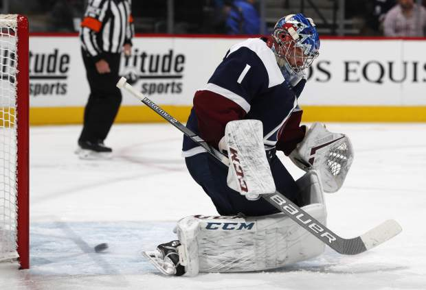 Colorado Avalanche goaltender Semyon Varlamov reacts after allowing a shot off the stick of Nashville Predators center Nick Bonino to go into the net for a goal in the second period of an NHL hockey game Monday, Jan. 21, 2019, in Denver. (AP Photo/David Zalubowski)