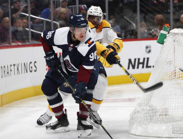Colorado Avalanche right wing Mikko Rantanen, front, tries to maneuver around the net with the puck as Nashville Predators defenseman P.K. Subban covers in the first period of an NHL hockey game Monday, Jan. 21, 2019, in Denver. (AP Photo/David Zalubowski)