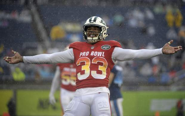 AFC safety Jamal Adams (33), of the New York Jets, celebrates after sacking NFC quarterback Mitchell Trubisky, of the Chicago Bears during the second half of the NFL Pro Bowl football game Sunday, Jan. 27, 2019, in Orlando, Fla. (AP Photo/Phelan Ebenhack)