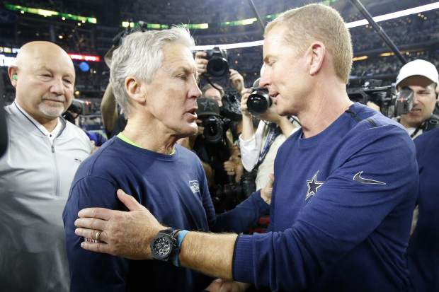 Seattle Seahawks head coach Pete Carroll, left, speaks with Dallas Cowboys head coach Jason Garrett after the NFC wild-card NFL football game in Arlington, Texas, Saturday, Jan. 5, 2019. The Cowboys won 24-22. (AP Photo/Michael Ainsworth)