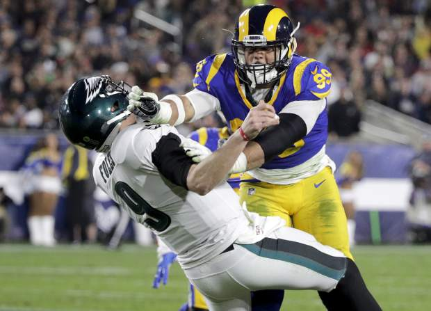 96931d995ff 16, 2018, file photo, Los Angeles Rams defensive end Aaron Donald hits  Philadelphia Eagles quarterback Nick Foles after Foles threw the ball away  during the ...