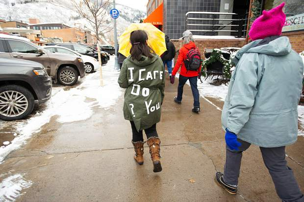 Men and women march to the pedestrian mall in Aspen on Saturday for the third annual Women's Ski and March for Decency and Truth. The event was hosted by Pitkin County Democrats and had an assortment of speakers at Paepcke Park including Colorado State Representative Julie McCluskie.