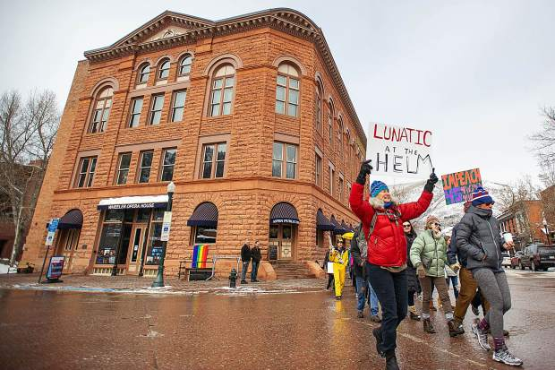 Men and women including, Linda Lafferty, left, march to the pedestrian mall in Aspen on Saturday for the third annual Women's Ski and March for Decency and Truth. The event was hosted by Pitkin County Democrats and had an assortment of speakers at Paepcke Park including Colorado State Representative Julie McCluskie.