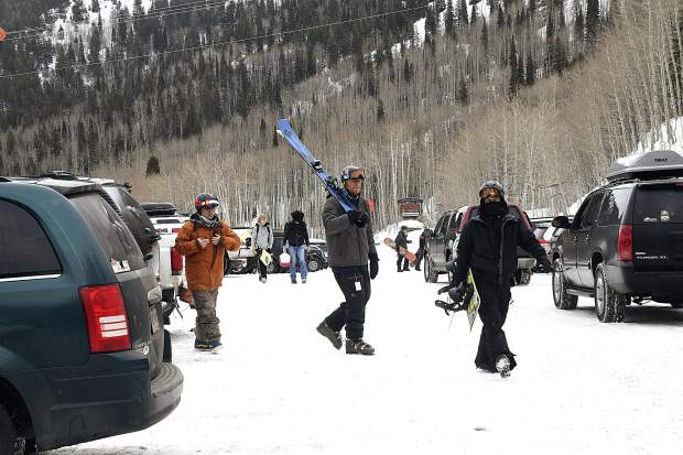 Skiers and riders make their way to the lodge for the 34th annual Skier Appreciation Day Friday at Sunlight Mountain Resort.