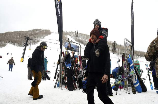 Skiers and riders make their way to ticket window for the $20 lift tickets at the 34th annual Skier Appreciation Day Friday at Sunlight Mountain Resort.